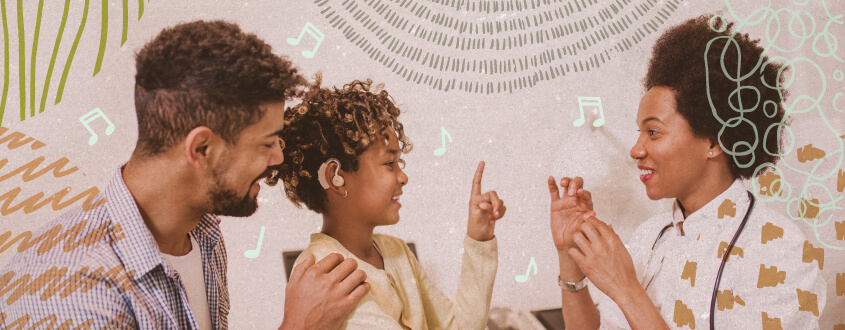 photo showing parent and professional using music to support language development in child with hearing loss